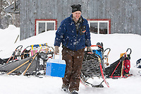 Tim Hunt hauls his replacement sled to his dog team at McGrath during Iditarod 2009