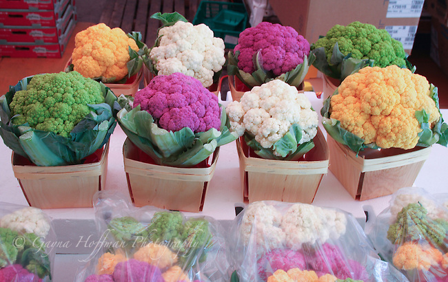 Baskets holding green, pink, yellow and white cauliflower heads, marche, market, Montreal, Canada, Quebec, food, produce, vegetables, fresh,