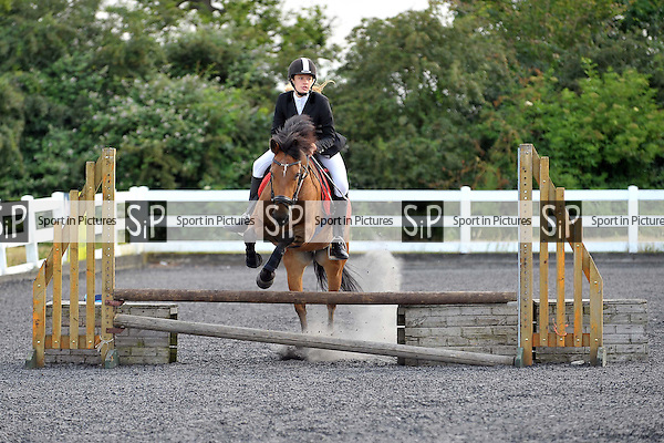 Class 2. 55cm. Wednesday night showjumping. Norton Heath Equestrian Centre. Essex. 02/07/2014. MANDATORY Credit Ellie Ingram/Sportinpictures - NO UNAUTHORISED USE - 07837 394578