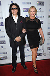 Gene Simmons and Shannon Tweed-Simmons at the Mending Kids Gala Honoring Gene Simmons and family, held at the Santa Monica Airport Hanger 8 on November 9, 2013