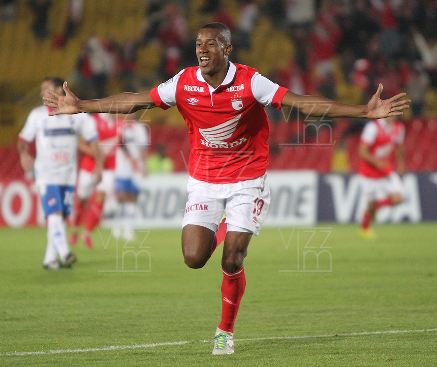 BOGOTA -COLOMBIA. 11-02-2014. Jonathan  Copete  de Independiente Santa Fe de Colombia celebra su  gol   contra  Nacional  de Paraguay  durante el partido de ida de La Copa Bridgestone Libertadores de America   disputado en el estadio El Campin. / Jonathan  Copete  of Independiente Santa Fe of Colombia celebrates his goal  against Nacional of Paraguay  XXXX during firts  leg of the Copa Libertadores de America Bridgestone played at El Campin stadium . Photo: VizzorImage / Felipe Caicedo / Staff