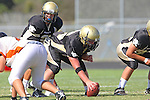 Palos Verdes, CA 09/22/11 - Ian Escutia (Peninsula #2) and Luca Sartini (Peninsula #73)) in action during the Beverly Hills-Peninsula Varsitty Football gane.
