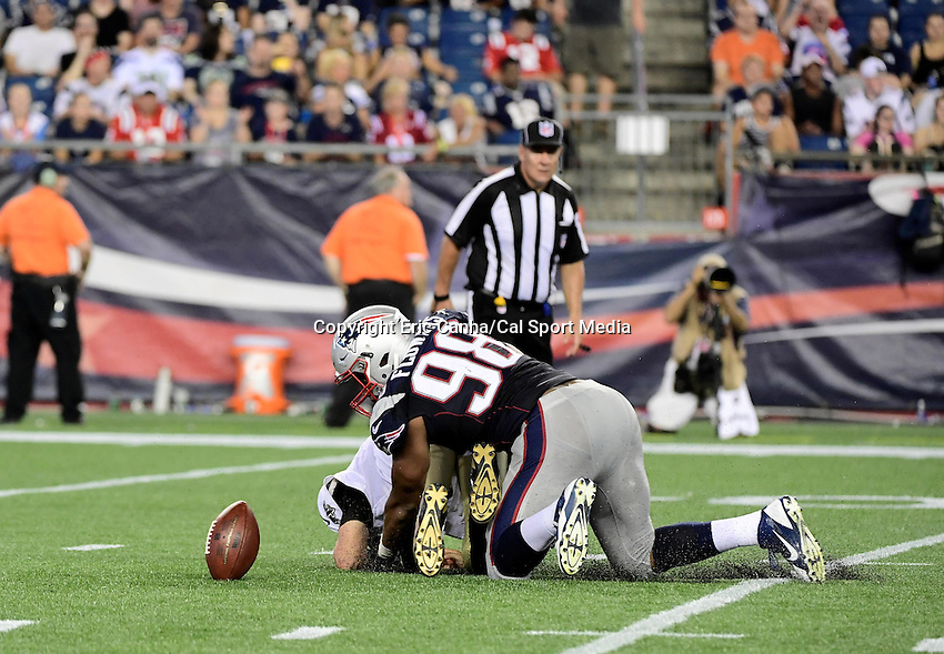 Thursday August 11, 2016: New England Patriots defensive end Trey Flowers (98) strips the ball from New Orleans Saints quarterback Luke McCown (7) during an NFL pre-season game between the New Orleans Saints and the New England Patriots held at Gillette Stadium in Foxborough Massachusetts. The Patriots defeat the Saints 34-22 in regulation time. Eric Canha/CSM