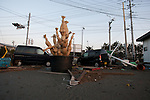 Mar. 13, 2011 - Ibaraki, Japan - Vehicles are seen piled up two days after the 8.9 magnitude earthquake followed by a tsunami that hit the north-eastern region of Japan. The current number of deaths in this disaster are reported to be well into the thousands according to media reports.