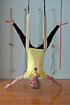 "Prior to leading a noon-time Iyengar yoga class, 73-year-old yoga instructor Nicole ""Nicky"" Plaut warms up with an inverted pose in a yoga sling at the Mound Street Yoga Center in Madison, Wis., on May 15, 2003.  Plaut, a native of Belgium, has been practicing yoga for more than 50 years and teaches 14 inspired but humbling, yoga classes per week at several Madison-area locations."