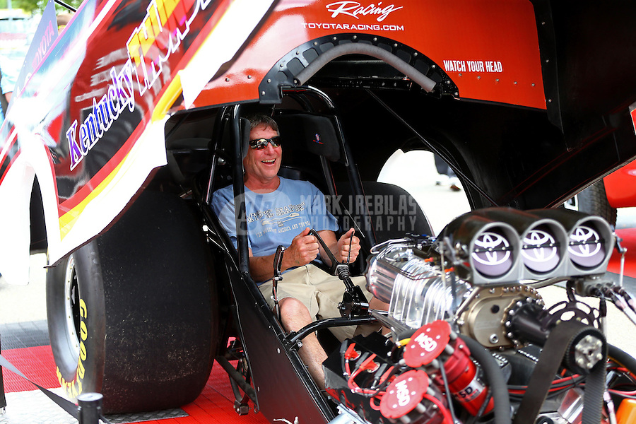 """May 30, 2014; Englishtown, NJ, USA; NHRA a fansits in the Toyota funny car, """"Kentucky Thunder"""" at the Toyota display during qualifying for the Summernationals at Raceway Park. Mandatory Credit: Mark J. Rebilas-"""