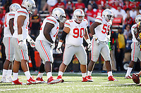 Ohio State defensive line players, from right, defensive lineman Tyquan Lewis (59), defensive lineman Tommy Schutt (90), defensive lineman Chris Carter (72), defensive lineman Rashad Frazier (17) and linebacker Curtis Grant (14) line up against the Maryland Terrapins during the Buckeyes' 52-24 win in the NCAA football game at Byrd Stadium in College Park, Maryland on Oct. 4, 2014. (Adam Cairns / The Columbus Dispatch)