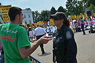 August 31, 2013  (Washington, DC)  A Syrian-American protester questions a U.S. Park Police officer during a rally to support a free Syria in front of the White House August 31, 2013.   (Photo by Don Baxter/Media Images International)