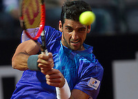 Il brasiliano Thomaz Bellucci in azione contro il serbo Novak Djokovic durante gli Internazionali d'Italia di tennis a Roma, 14 maggio 2015. <br /> Brazil's Thomaz Bellucci in action against Serbia's Novak Djokovic during the Italian Open tennis tournament in Rome, 14 May 2015.<br /> UPDATE IMAGES PRESS/Riccardo De Luca