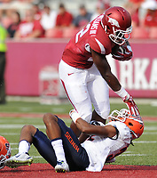 NWA Democrat-Gazette/ANDY SHUPE<br /> Arkansas' Rawleigh Williams III is tackled by University of Texas at El Paso's Kalon Beverly Saturday, Sept. 5, 2015, during the fourth quarter of play in Razorback Stadium in Fayetteville. Visit nwadg.com/photos to see more from the game.