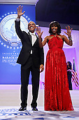 United States President Barack Obama and first lady Michelle Obama wave goodbye after attending the Inaugural Ball at the Walter Washington Convention Center January 21, 2013 in Washington, DC. President Obama started his second term by taking the Oath of Office earlier in the day during a ceremony on the West Front of the U.S. Capitol. .Credit: Chip Somodevilla / Pool via CNP