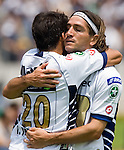 UNAM Pumas forward Bruno Marioni (R) is congratulated by his teammate Ismael Iniguez after scoring a goal against Tigres of the UANL Tigres during their soccer match at the University Stadium in Mexico City, April 23, 2006. UNAM Pumas tied 1-1 to UANL Tigres. Photo by © Javier Rodriguez