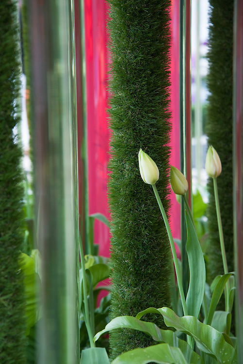 Green with... garden, designed by Tony Smith for Easigrass - the Artificial Grass Company, RHS Chelsea Flower Show 2012. Columns of perspex and artificial grass intrerplanted with ferns and tulips.