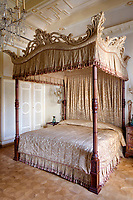 The opulent 19th century apartment  exudes sensuality, fantasy and passion. In the bedroom, the impressive four-poster bed is the pièce de résistance.
