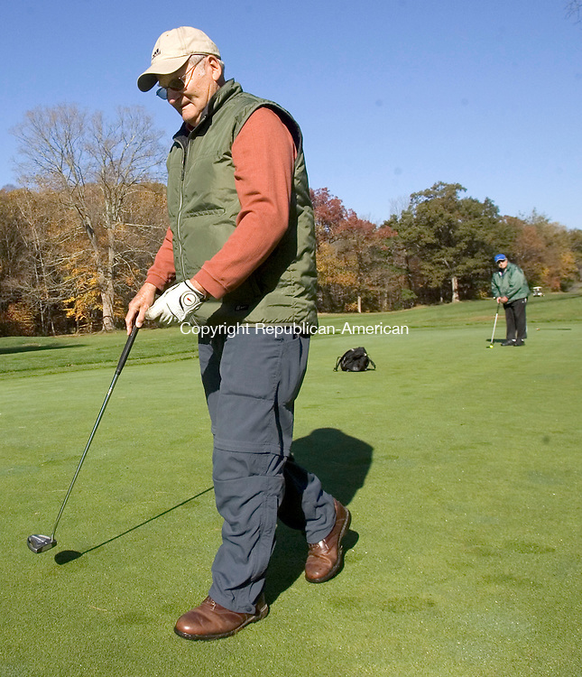 NAUGATUCK CT. 21 October 2013-102113SV05-John Delpo of Middlebury enjoys a relaxing game of golf with friends at Hop Brook golf course in Naugatuck Monday. The group was having a little fun while exercising on the cool fall day.<br /> Steven Valenti Republican-American