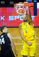 Boomers centre Andrew Bogut slam dunks as Rob Loe (left) looks on during the FIBA Oceania men's tournament basketball match between New Zealand and Australia at TSB Bank Arena, Wellington, New Zealand on Tuesday, 18 August 2015. Photo: Dave Lintott / lintottphoto.co.nz