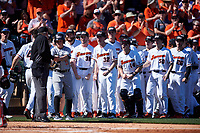 The Oregon State Beavers prepare to mob Alex McGarry (44) after hitting a home run during an NCAA game against the New Mexico Lobos at Surprise Stadium on February 14, 2020 in Surprise, Arizona. (Zachary Lucy / Four Seam Images)