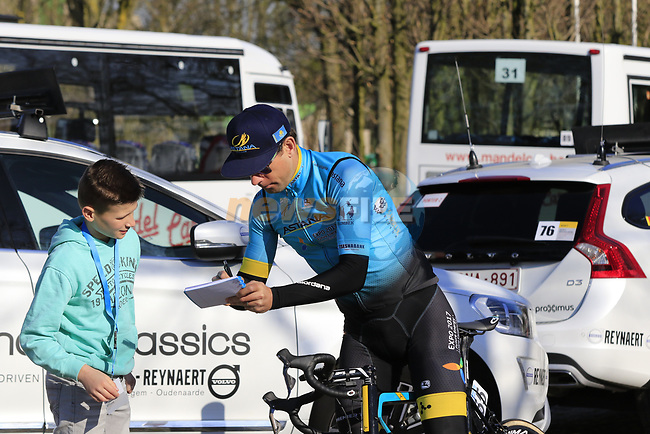 Dmitriy Gruzdev (KAZ) Astana Pro Team signs an autograph for a young fan before the start of Gent-Wevelgem in Flanders Fields 2017, running 249km from Denieze to Wevelgem, Flanders, Belgium. 26th March 2017.<br /> Picture: Eoin Clarke | Cyclefile<br /> <br /> <br /> All photos usage must carry mandatory copyright credit (&copy; Cyclefile | Eoin Clarke)