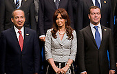Pittsburgh, PA - September 25, 2009 -- Group of 20 nations leaders, from left, Felipe Calderon, president of Mexico, Cristina Fernandez de Kirchner, president of Argentina, and Dmitry Medvedev, president of Russia, wait for a G-20 family photo on day two of the G-20 summit in Pittsburgh, Pennsylvania, U.S., on Friday, September 25, 2009. G-20 leaders are working on an accord to prevent a repeat of the worst global financial crisis since the Great Depression and ensure a sustained recovery. .Credit: Andrew Harrer / Pool via CNP