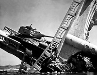 The wreckage of a bridge and North Korean Communist tank south of Suwon, Korea.  The tank was caught on a bridge and put out of action by the Air Force.  October 7, 1950. Marks. (Army)<br /> NARA FILE #:  111-C-6143<br /> WAR &amp; CONFLICT BOOK #:  1499