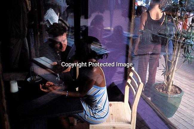 JOHANNESBURG, SOUTH AFRICA - JUNE 15: An unidentified racially mixed couple having coffees in a cafe on June 15, 2002 in Newtown, an art district in downtown Johannesburg, South Africa. More and more people come to visit downtown Johannesburg, mostly known for its crime statistics and emptiness after dark. . Artists are moving to downtown Johannesburg to rent abandoned factories and great loft spaces for very cheaply. .Photo: Per-Anders Pettersson / iAfrika Photos.....