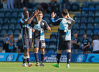 Anthony Stewart (left) of Wycombe Wanderers and Luke O'Nien (centre) of Wycombe Wanderers celebrate the win with Joe Jacobson of Wycombe Wanderers during the Sky Bet League 2 match between Wycombe Wanderers and York City at Adams Park, High Wycombe, England on 8 August 2015. Photo by Andy Rowland.