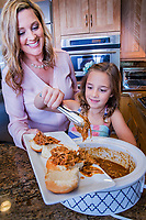 Jenn Bare gets help on a Barbeque Chicken  Crock pot recipe from her daughter Bali, 8, in the kitchen in Scottsdale.