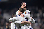 James Rodriguez of Real Madrid (top) celebrates with teammates Daniel Carvajal Ramos (left) and Cristiano Ronaldo during the match Real Madrid vs Napoli, part of the 2016-17 UEFA Champions League Round of 16 at the Santiago Bernabeu Stadium on 15 February 2017 in Madrid, Spain. Photo by Diego Gonzalez Souto / Power Sport Images