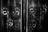 Wroclaw 23.08.2006 Poland<br /> The worst and the most dangerous district in Wroclaw ( Poland ), called by people &quot;The Bermuda Triangle&quot;. There are walls bearing an inscription &quot;Who will enter here, will not exit alive&quot; Many families there are pathological and live in extreme poverty. Children have no place for any games so they loaf around on this wasted district and disseminate a juvenile delinquency. Many of them become sexually active though they are only 10-12 years old<br /> (Photo by Adam Lach / Napo Images)<br /> <br /> Najbardziej nabezpieczna dzielnica we Wroclawiu zwana przez ludzi Trojkatem Bermudzkim. Sa tam sciany opatrzone napisem &quot; Kto tu wejdzie, nigdy nie wyjdzie stad zywy&quot; Mieszka tam wiele rodzin patologicznych i zyja w wielkiej nedzy. Dzieci wlocza sie po ulicach nie majac miejsc na zabawe i szerza przestepczosc wsrod nieletnich. Wiele z dzieci uprawia seks choc maja zaledwie 10-12 lat<br /> (Fot Adam Lach / Napo Images)