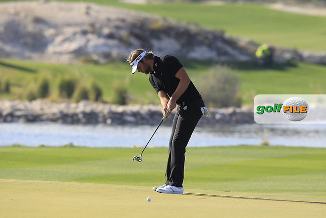 Johan CARLSSON (SWE) putts on the 15th green during Saturday's Final Round of the 2015 Commercial Bank Qatar Masters held at Doha Golf Club, Doha, Qatar.: Picture Eoin Clarke, www.golffile.ie: 1/24/2015