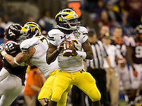 Michigan quarterback Denard Robinson prepares to throw the ball during Sugar Bowl game at Mercedes-Benz SuperDome in New Orleans, Louisiana on January 3rd, 2012.   Michigan defeated Virginia Tech, 23-20 in first overtime.