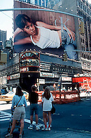 Calvin Klein Billboard in Times Square August 19, 1995. Billboard is over the closed Nathan's on the Southeast corner of West 43 St. and Broadway. The site is now occupied by the Conde Nast Building with Nasdaq in the exact location. (© Frances M. Roberts)