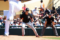 Miami Marlins outfielder Tyler Colvin (26) leads off first as umpire Greg Gibson looks on during a Spring Training game against the Detroit Tigers on March 25, 2015 at Joker Marchant Stadium in Lakeland, Florida.  Detroit defeated Miami 8-4.  (Mike Janes/Four Seam Images)