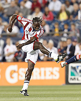 Chivas USA midfielder Shalrie Joseph (18) follows through on a shot. In a Major League Soccer (MLS) match, the New England Revolution tied Chivas USA, 3-3, at Gillette Stadium on August 29, 2012.
