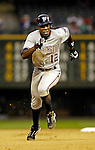 8 September 2006: Alfonso Soriano, left fielder for the Washington Nationals, on his way to stealing his 38th base of the season in the first inning against the Colorado Rockies. The Rockies defeated the Nationals 11-8 at Coors Field in Denver, Colorado...Mandatory Photo Credit: Ed Wolfstein.
