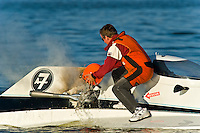 "Duff Daily, A-7 ""Southern Magic"", 2.5 Litre Mod hydroplane..Frame 4: Miami fireman Duff Daily pulls the A-7 off course with an engine fire and proceeds extinguish it using his crash helmet as a bucket."