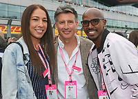 Tania Farah, Lord Sebastian Coe and Sir Mo Farah during the Formula 1 Rolex British Grand Prix 2019 at Silverstone Circuit, Towcester, England on 14 July 2019. Photo by Vince  Mignott.