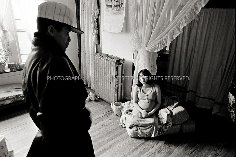 1993--Chicago, USA.Ricky and his preganant wife in his family's apartmentin Uptown...All photographs ©2003 Stuart Isett.All rights reserved.This image may not be reproduced without expressed written permission from Stuart Isett.