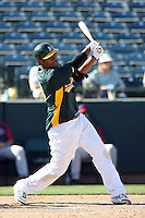 Michael Taylor #23 of the Oakland Athletics bats against the Cleveland Indians in a spring training game at Phoenix Municipal Stadium on March 2, 2011  in Phoenix, Arizona. .Photo by:  Bill Mitchell/Four Seam Images.