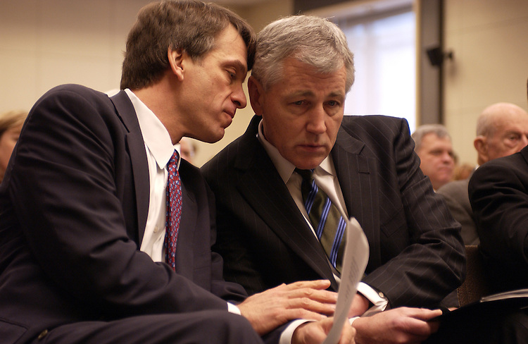 Environment Scholar David Sandalow of Brookings talks with Senator Chuk Hagel during a meeting on the the Kyoto Treaty in  Washington, D.C.