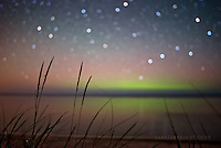 magic summer nights- aurora and bokeh stars over Lake Superior