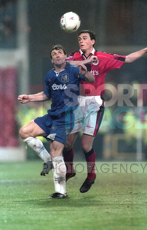 Steve Chattle of Nottingham Forest tussles with Mark Hughes of Chelsea - Premier League - Nottingham Forest v Chelsea - City Ground - Nottingham - England - 11th January 1997 - Picture Simon Bellis/Sportimage