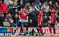 Tom Parkes of Leyton Orient is reminded by Referee Charles Breakspear that he is sent off as Garry Thompson of Wycombe Wanderers lays injured during the Sky Bet League 2 match between Leyton Orient and Wycombe Wanderers at the Matchroom Stadium, London, England on 1 April 2017. Photo by Andy Rowland.