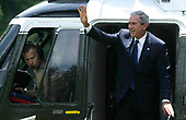 United States President George W. Bush waves on the steps of the Marine One as he returns to the White House June 8, 2008 in Washington, DC. Bush spent his weekend at Camp David.  <br /> Credit: Alex Wong / Pool via CNP