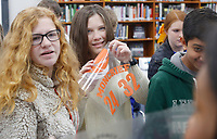 NWA Democrat-Gazette/DAVID GOTTSCHALK Brooklyn Farmer (center), an eighth grade honor student at Central Junior High School,  holds up a design for a print Monday, December 3, 2018, during the Moncrief Game Changer Entrepreneurship Summit at the school in Springdale. The summit, sponsored by the Schmieding Foundation, featured workshops that included written expression, sales skills and first impression development.