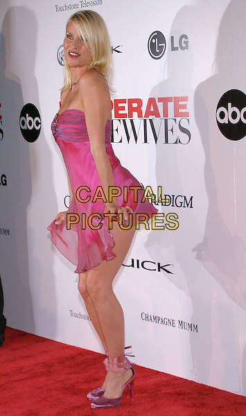 NICOLLETTE SHERIDAN.'Desparate Housewives' - New ABC Series Viewing Party.at Barney's Beverly Hills Store. .October 3rd, 2004.full length, pink dress, posing, funny, gesture, chiffon, pink ribbon heels.www.capitalpictures.com.sales@capitalpictures.com.©Jacqui Wong/AdMedia/Capital Pictures.