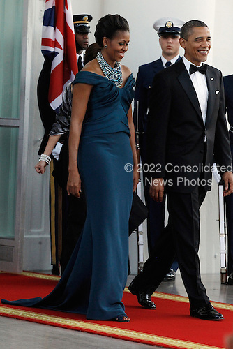 First lady Michelle Obama and U.S. President Barack Obama await the arrival of British Prime Minister David Cameron and his wife Samantha on the North Portico of the White House March 14, 2012 in Washington, DC. Cameron is on a three-day visit to the U.S. and he was expected to have talks with Obama on the situations in Afghanistan, Syria and Iran. .Credit: Chip Somodevilla / Pool via CNP