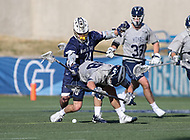 Washington, DC - February 27, 2018: Mt. St. Mary's Mountaineers Chris DiPretoro (24) hits \Georgetown Hoyas Stephen MacLeod (48) during game between Mount St. Mary's and Georgetown at  Cooper Field in Washington, DC.   (Photo by Elliott Brown/Media Images International)