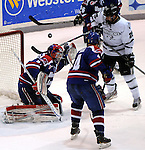 (Providence RI 030913)The puck flies off the pads of Lowell goalie Connor Hellebuyck in the first period, Providence 25, Kevin Rooney, UMass 4, Joe  during the game with between UMass Lowell and Providence, Saturday, March 9, 2013, in Providence. (Jim Michaud  Photo) For Sunday.