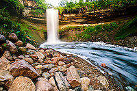 "53 foot tall Minnehaha falls on Minnehaha Creek. The translation of the name is ""curling water"" or ""waterfall"". The name comes from the Dakota language elements mni, meaning water, and haha, meaning waterfall."